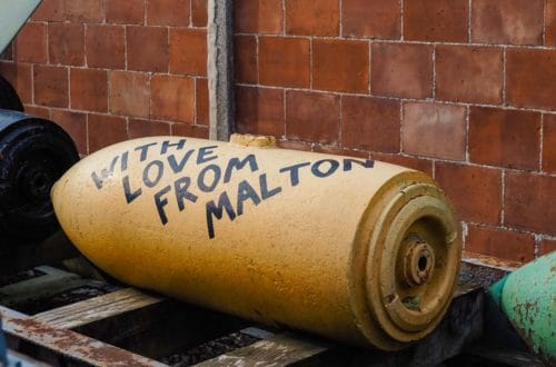 """Bomb at Eden Camp marked with the words """"with love from Malton"""""""
