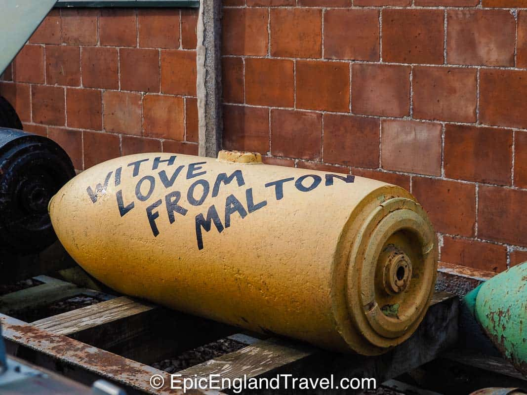 "Bomb at Eden Camp marked with the words ""with love from Malton"""