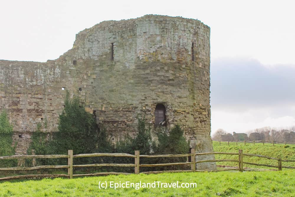 One of the four imposing towers of Pevensey Castle