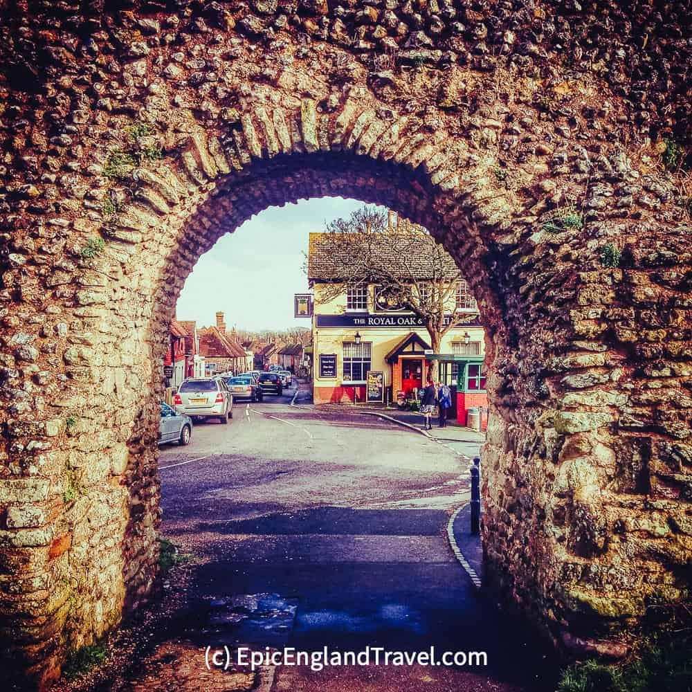 A stone arch gateway to Pevensey village