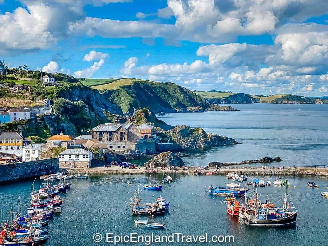 cornwall coastline with fishing boats and village