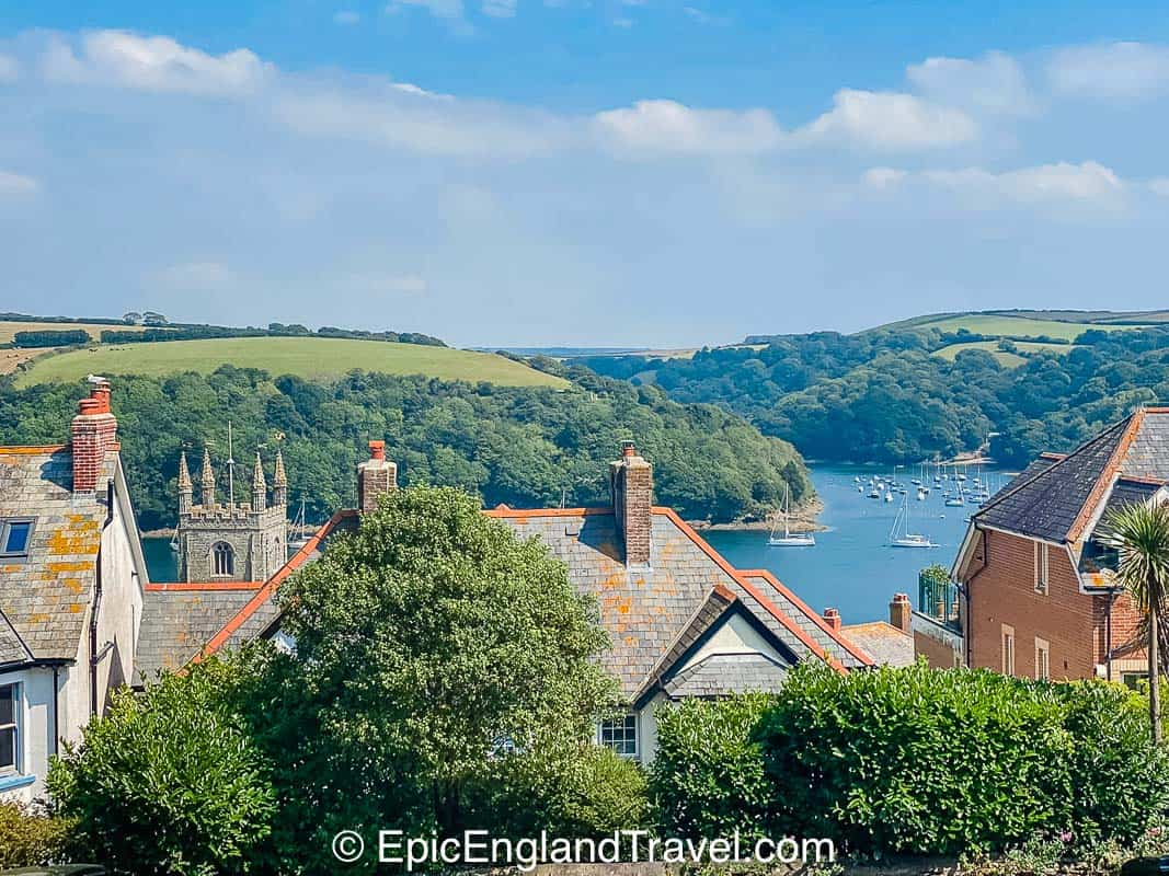 the rooftops of Fowey with a view of the estuary and rolling hills